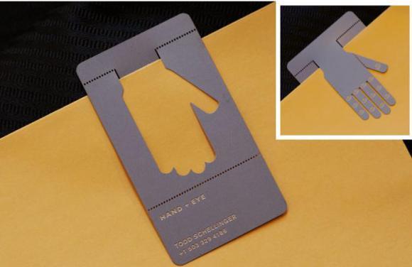 Contoh kartu nama yang dapat digunakan sebagai penjepit kertas, produk : Hand Eye /gambar : firewireblog.com